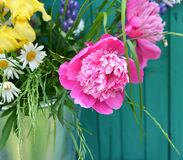 Still life with peonies and wildflowers Royalty Free Stock Image