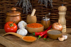 Still life with pepper and garlic with wooden utensils Stock Image