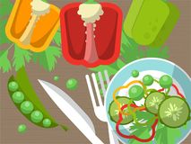 Still life with peppers, fork, knife and sliced vegetables on the table. Stock Photos