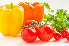 Still life with peppers, tomatoes and parsley. Still life with yellow and orange peppers, tomatoes and parsley royalty free stock photo