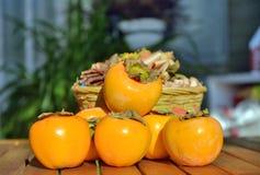 Still life, persimmon. Close-up Royalty Free Stock Image