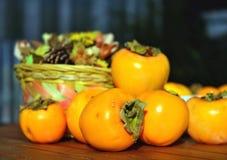 Still life, persimmon. Close-up Stock Photos