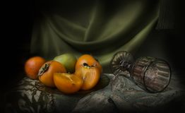 Still life with persimmon Royalty Free Stock Image