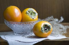 Still life with persimmons Stock Images