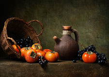 Still life with persimmons on the table Stock Image