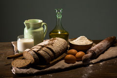 Still life photo of bread and flour with milk and eggs Royalty Free Stock Images