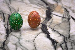 Still life photo of lots of colourful speckled candy covered chocolate easter eggs . Still life photo of lots of colourful speckled candy covered chocolate Royalty Free Stock Images