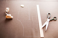 Still life photo of a suit pattern template with tape measure, c Stock Photos