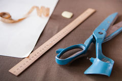 Still life photo of a suit pattern template with tape measure, c Royalty Free Stock Image