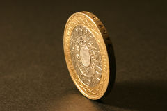 British Two Pound coin. Two pound coin in Uk currency photographed in a studio with coin on its side Stock Photography