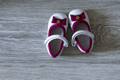 Still life photography: father and daughter shoes on wood floor royalty free stock photography