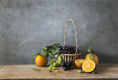 Still life Photography of friute. Still life Photography with fruit on wooden table and dark grunge background Stock Photography