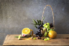 Still life Photography of friute. Still life Photography with fruit on wooden table and dark grunge background Royalty Free Stock Photography