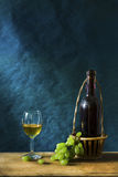 Still life Photography with Old white wine. Still life Photography with Old red wine on wooden table and blue grunge background Stock Image
