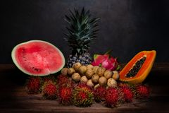 Still life photography of a pile of Thai fruit on the wooden tab. Le with light painting effect royalty free stock photo