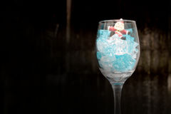 Still life Photography with Santa Claus in a glass of wine with ice in night time with dark background, Royalty Free Stock Images