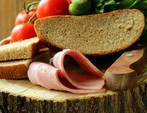 Still life picnic - ham, bread Stock Image
