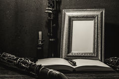 Still life of picture frame on wooden table with clarinet Stock Photography