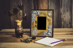 Still life picture frames, vases, dried rose notebook concept frequent memories. Stock Images