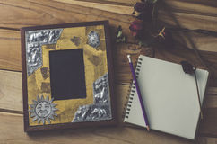 Still life picture frames, vases, dried rose notebook concept frequent memories. Stock Image