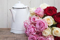 Still life with a coffee can and roses Royalty Free Stock Images