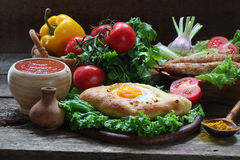 Still-life with a pie and ljulja-kebab submitted with fresh vege Royalty Free Stock Photos