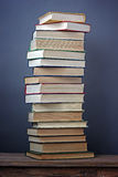 Still life with a pile of books. A vertical shot.T Royalty Free Stock Images