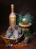 Still life with pine cones in the basket Royalty Free Stock Photography