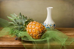 Still life with pineapple. On wooden table over grunge background royalty free stock images