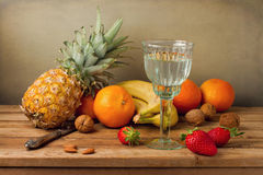 Still life with pineapple and assorted fruits. On wooden table royalty free stock images