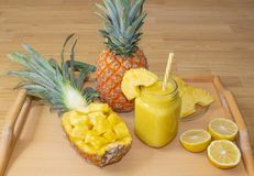 Still life. Pineapple juice, cocktails with fresh pineapple for breakfast in the morning on a wooden tray. Detox. For health and f. Or weight loss royalty free stock image