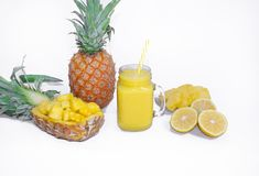 Still life. Pineapple juice, cocktails with fresh pineapple for breakfast in the morning on a white background. Detox. For health and for weight loss royalty free stock photo
