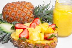 Still life. Pineapple juice, cocktails with fresh pineapple and fresh strawberries for breakfast in the morning stock image