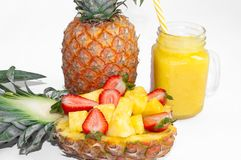 Still life. Pineapple juice, cocktails with fresh pineapple and fresh strawberries for breakfast in the morning royalty free stock photos