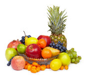 Still life - pineapple and other fruits on white. Still life - pineapple, apples and other fruits on white background stock photography