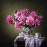 Still life with pink peonies. Vintage summer still life whith bouquet flowers Stock Photography