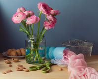 Still life with pink ranunculus flower bouquet Stock Photo