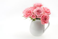 Still life of pink rose in ceramic cup Stock Photos