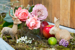 Still life with pink of rose beside Rabbit and deer Stock Images