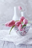 Still Life with Pink Tulips on a Tea Cup Royalty Free Stock Images