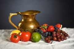 Still Life With Fruits. Still life with pitcher and fruits on table stock images
