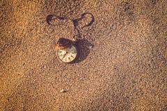 Still life - Pocket watch and sea shell Royalty Free Stock Photos