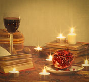 Still life with pomegranate, red wine, books and c Stock Photo