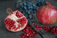 Still life of pomegranates and grapes Royalty Free Stock Photo
