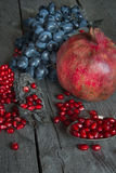 Still life of pomegranates and grapes Stock Images