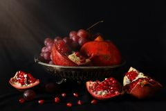 Still life with pomegranates and grapes Stock Photography