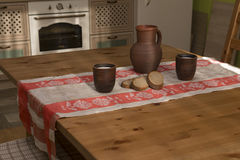 Still life with pottery, milk and bread in the kitchen. In the countryside Royalty Free Stock Photos