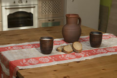 Still life with pottery, milk and bread in the kitchen. In the countryside Royalty Free Stock Image