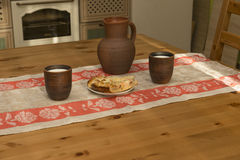 Still life with pottery, milk and pipe in the kitchen. In the countryside Stock Photos