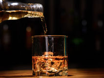 Still life. pour or whiskey in to glass.  Royalty Free Stock Image